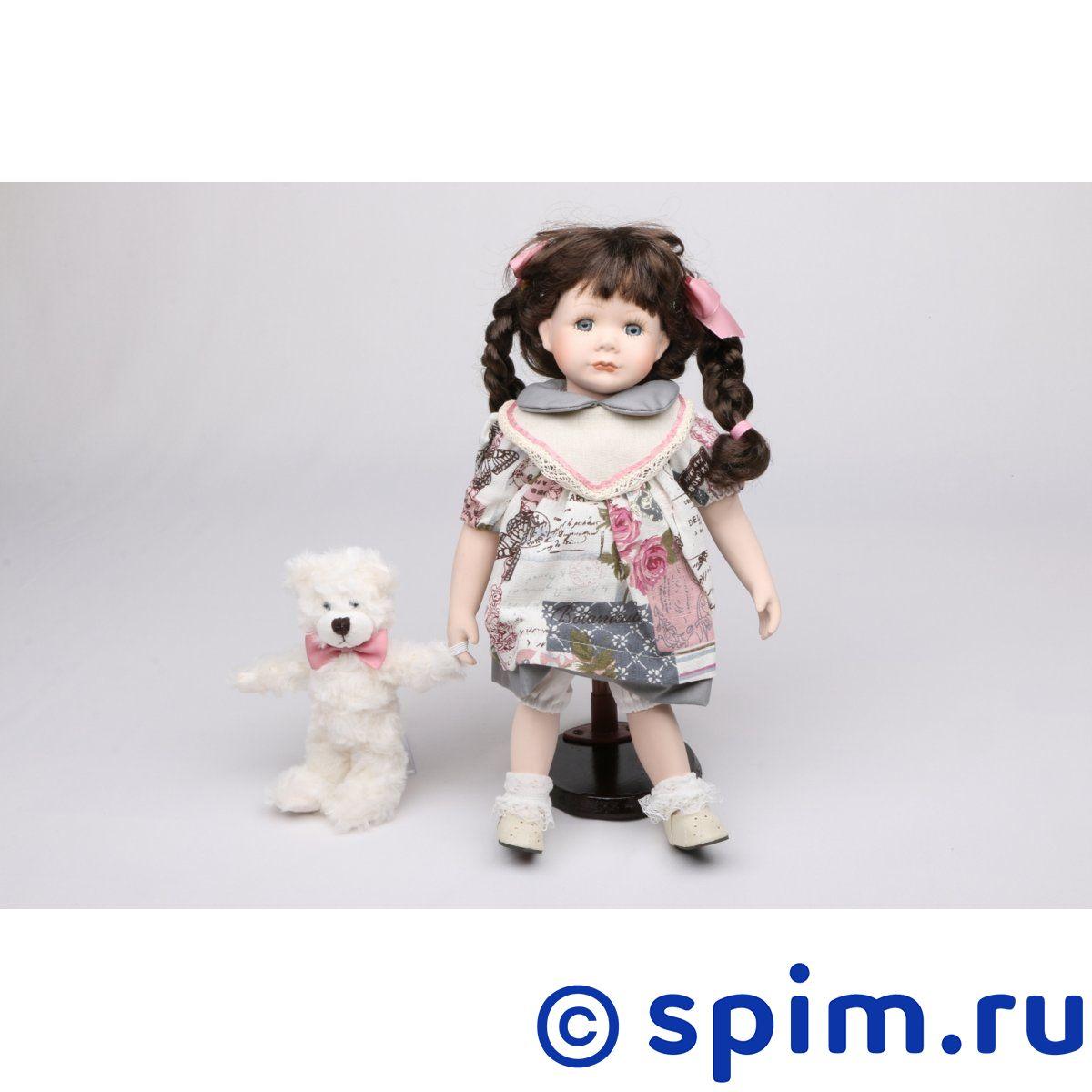 Интерьерная кукла Девочка с мишкой C21-148611Интерьерные куклы<br>Высота: 35 см. Состав: 60% керамика, 40% полиэстр, платье — текстиль, без механизма.<br>